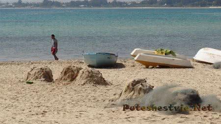 Сети и лодки рыбаков Хаммамета